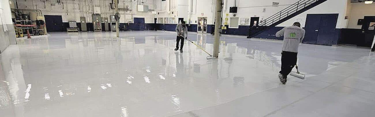 commercial concrete coatings being installed by applicators solid epoxy flooring