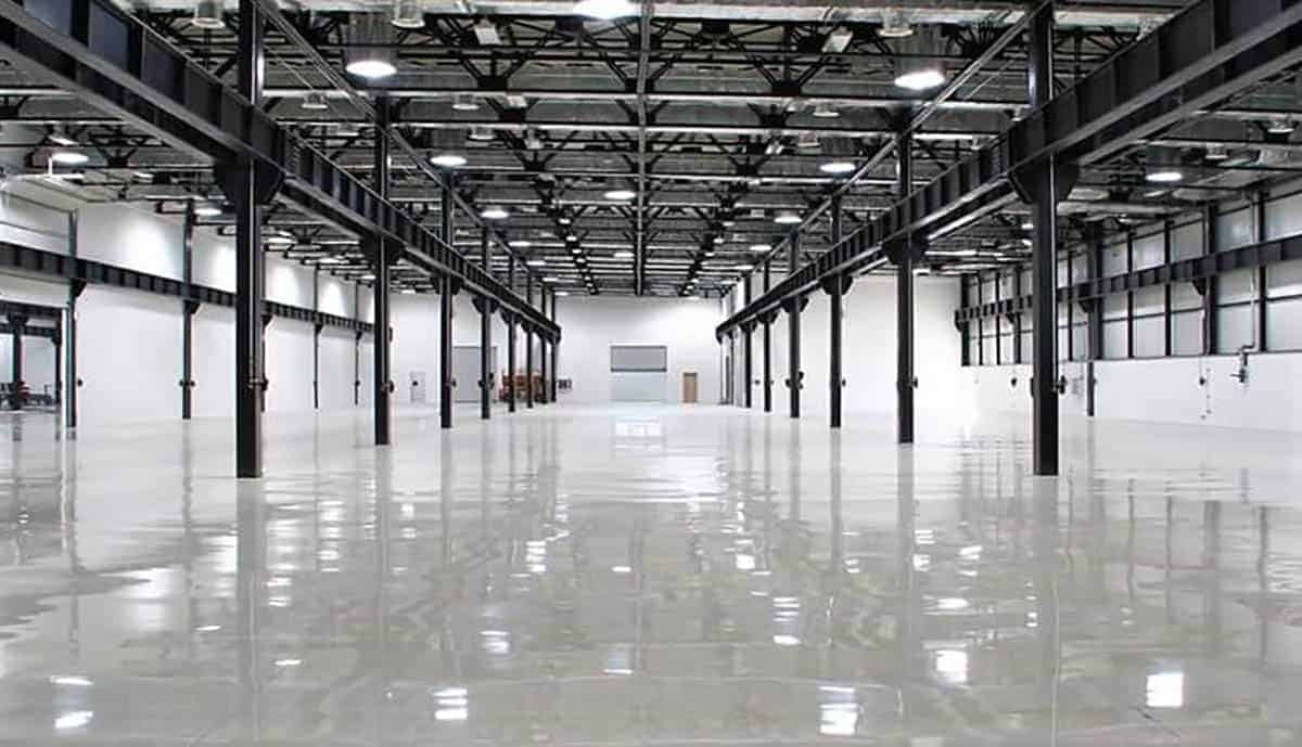 Large commercial space coated with gray high gloss epoxy flooring